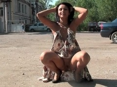 Black-haired Russian chick walking naked in public