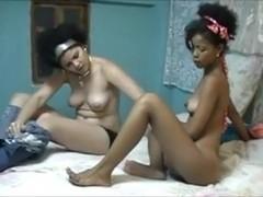 Two busty ebony babes having passionate lesbo fucking