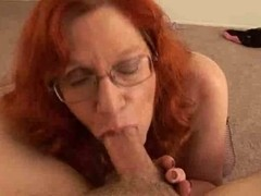 Mature redhead gets a cumshot on her big tits