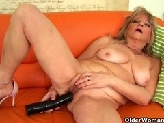 Granny with saggy mounds copulates a biggest vibrator