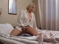 Mature Russian slut Nadine masturbates