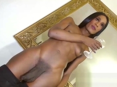 Stunning Black shemale wobbles large big cock webcam