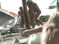 Tempting women sunbathing in a nude beach video