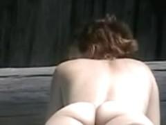 Redhead at nude beach