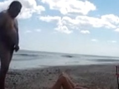 Nudist wife jerks off strangers at the beach and they cum on her