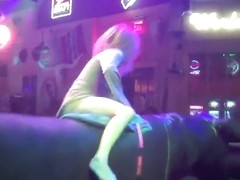Riding the mechanical bull uncovers blonde's sexy ass