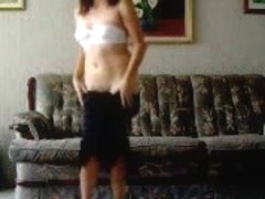 Hot Latina strip-dancing and demonstrating her body
