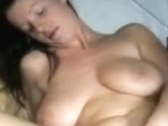 MILF with massive boobs masturbates