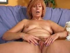 Redheaded granny masturbates her shaggy vagina