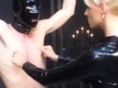Female-Dom in latex catsuit torturing poor villein