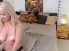 Milf Shows Off Strap-On With A Toy In Her Ass On Cam