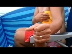 Compliation of Beach tugjob and large cumshots