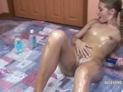 Lina overspread in oil and fucking a vibrator
