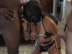 Slave girl in latex dominated in a group sex party
