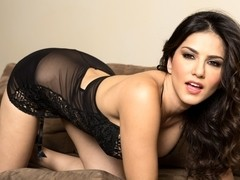 Sunny Leone in Sunny's Couch Strip Tease Video