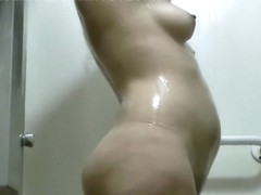 Spying on a curvy goddess as she takes a shower