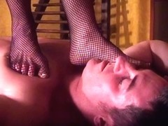 Bitch Goddess Amberle, in fishnets, walking all over her tied villein
