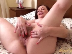 Video from AuntJudys: curvy mommy dips her fingers into hairy muff