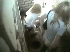 Two blonde babes caught on hidden camera in a toilet