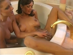 Crissy Moran and Jana Cat playing in the tub