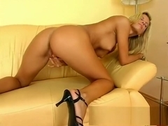 Allanis has a long dildo driving her aching pussy to intense pleasure