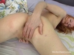 Alexia groans with fingers inside her
