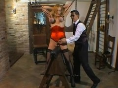 Blonde slave girl tied and tortured in the dungeon