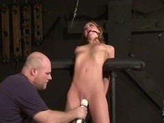 Toned hottie gets a sex toy torture BDSM style