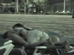 Voyeur tapes a dude with soccer shirt fucking a partyslut at the beach