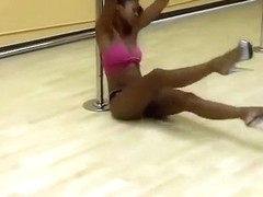 Black babe dances in front of the mirror
