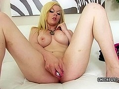 Blonde hottie Taylor Boots stuffs her twat with a toy