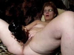 Mature slut masturbating with huge sex toy up her cunt
