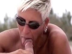 Nudist female sucking dick on beach voyeur camera