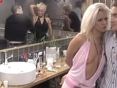 Blonde slut teasing man with nude titties downblouse
