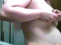 Hidden of MILF wife squeezing tit and nipple