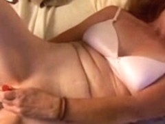 Hot cougar bonks her soaked vagina with her much loved toys until