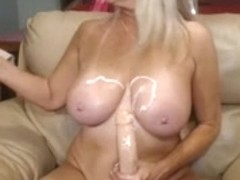 Blonde cougar fucks her cunt with a big dildo