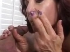 Sexy older brunette hair masterfully sucks knob whilst smokin' a cigarette