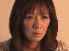 Japanese AV Model is a hot mature babe in upskirt shots