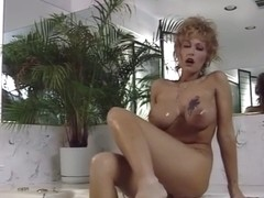 Big tit milf taking a bath
