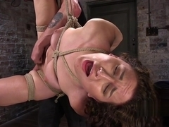 Hogtied babe gets feet and anal tormented