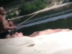 Hot nude blonde sunbathing filmed by hidden beach camera
