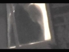 Raunchy window voyeur pics of the hot round titties