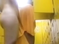 Asian bimbo toweling herself after shower in change room