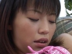 Leg spreading Japanese chick buffing her pearl under her undies