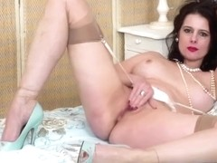 Sexy Milf Karina Currie wanks in vintage lingerie nylons leather stilettos