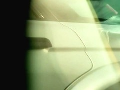 A voyeur films the crotch of a girl getting into her car