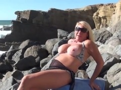 Busty MILF beach flashing tits