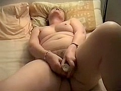 Fat granny plays with a big dildo