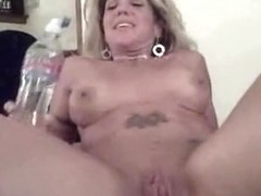 Big tittied horny wife fucking her black partner on the bed